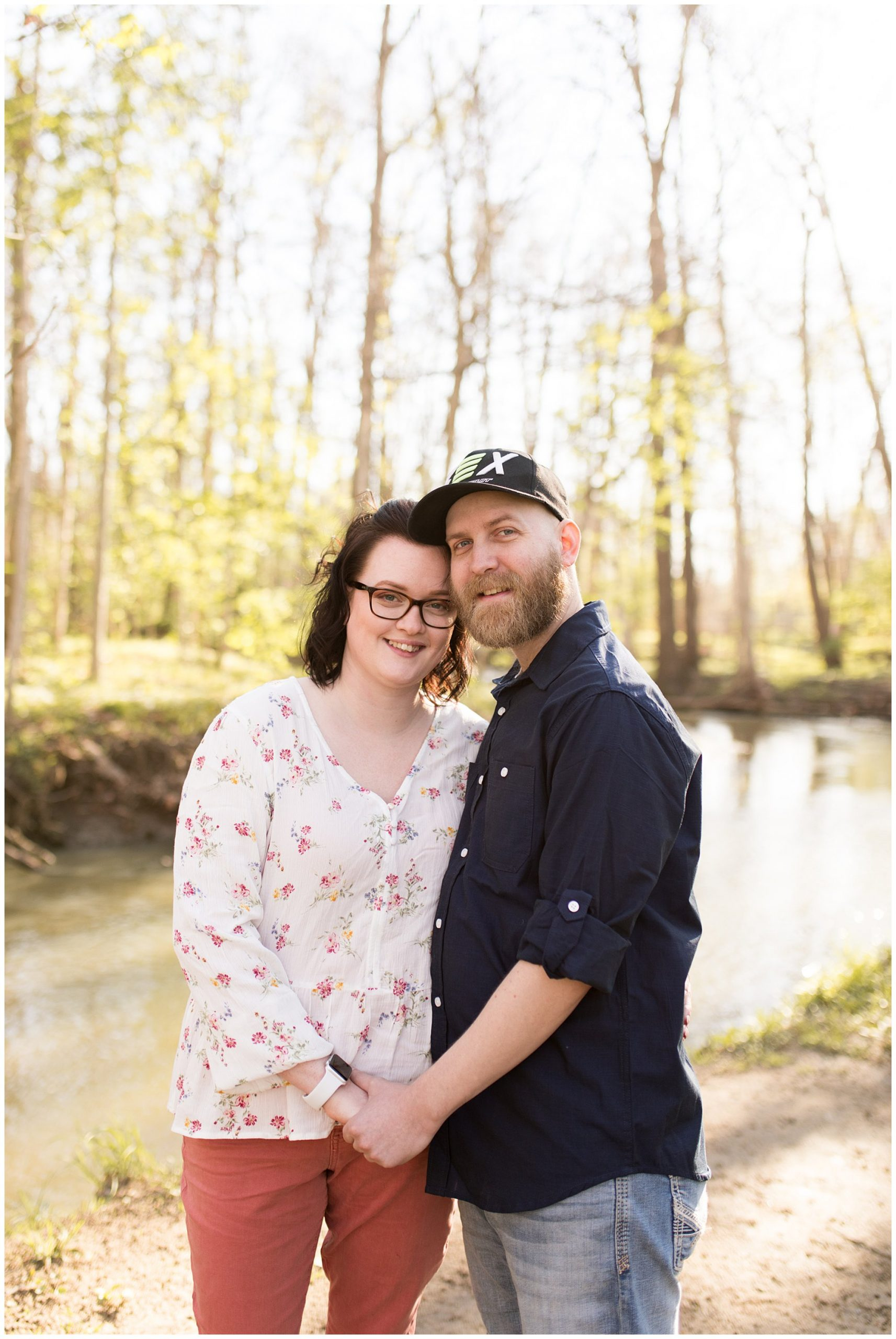couple holds hands during Jackson Morrow Park engagement session
