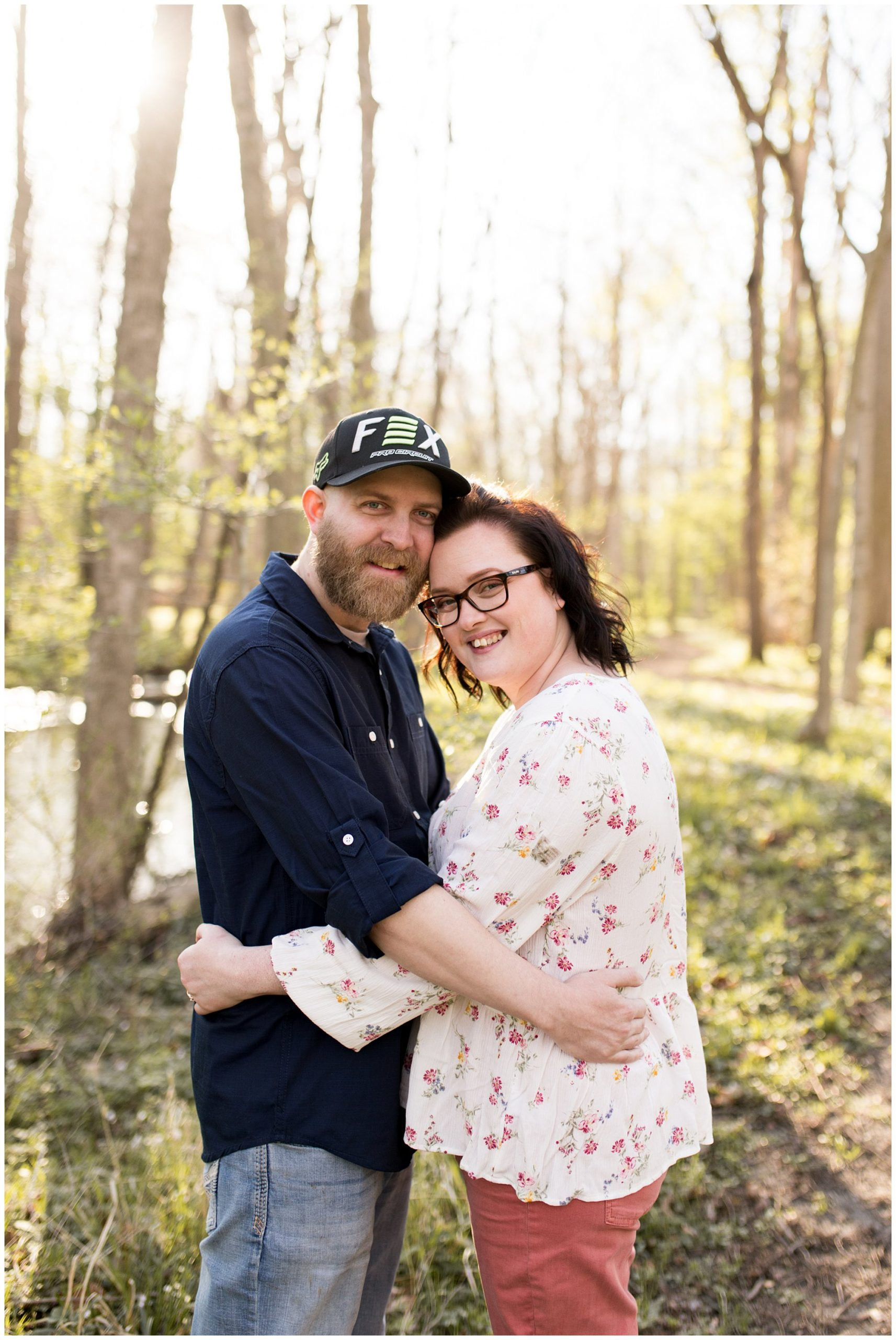 couple holds each other during springtime engagement session in Kokomo