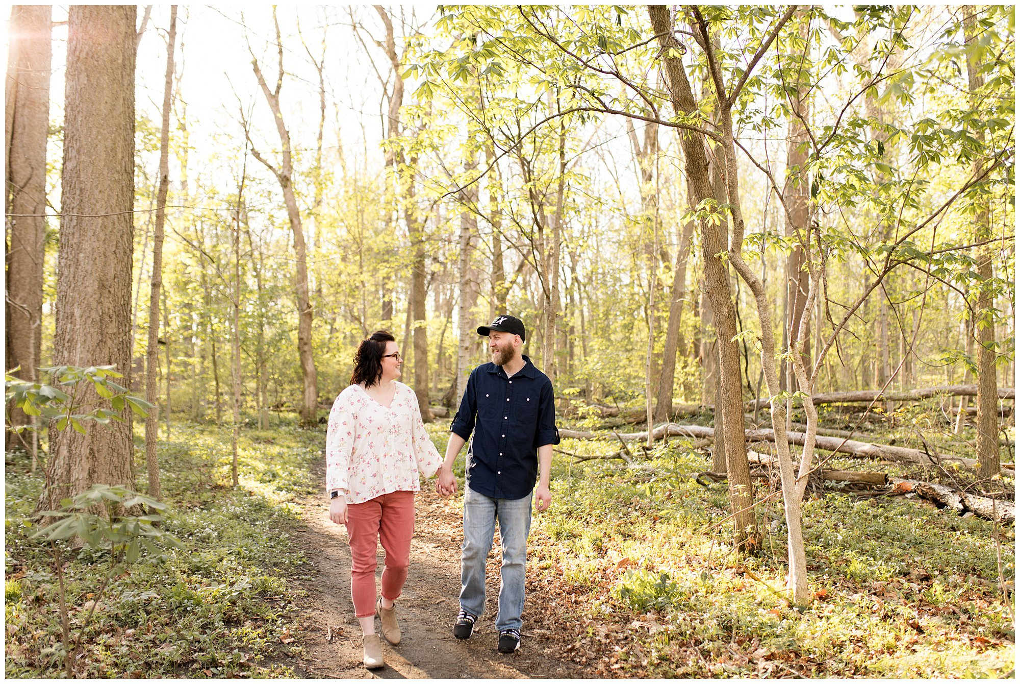 couple walks and holds hands during engagement session in Kokomo