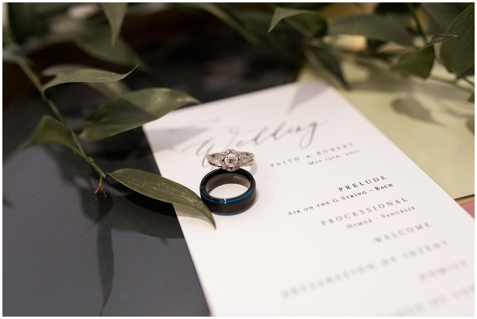 bride's ring on top of groom's rings at BASH venue in Carmel