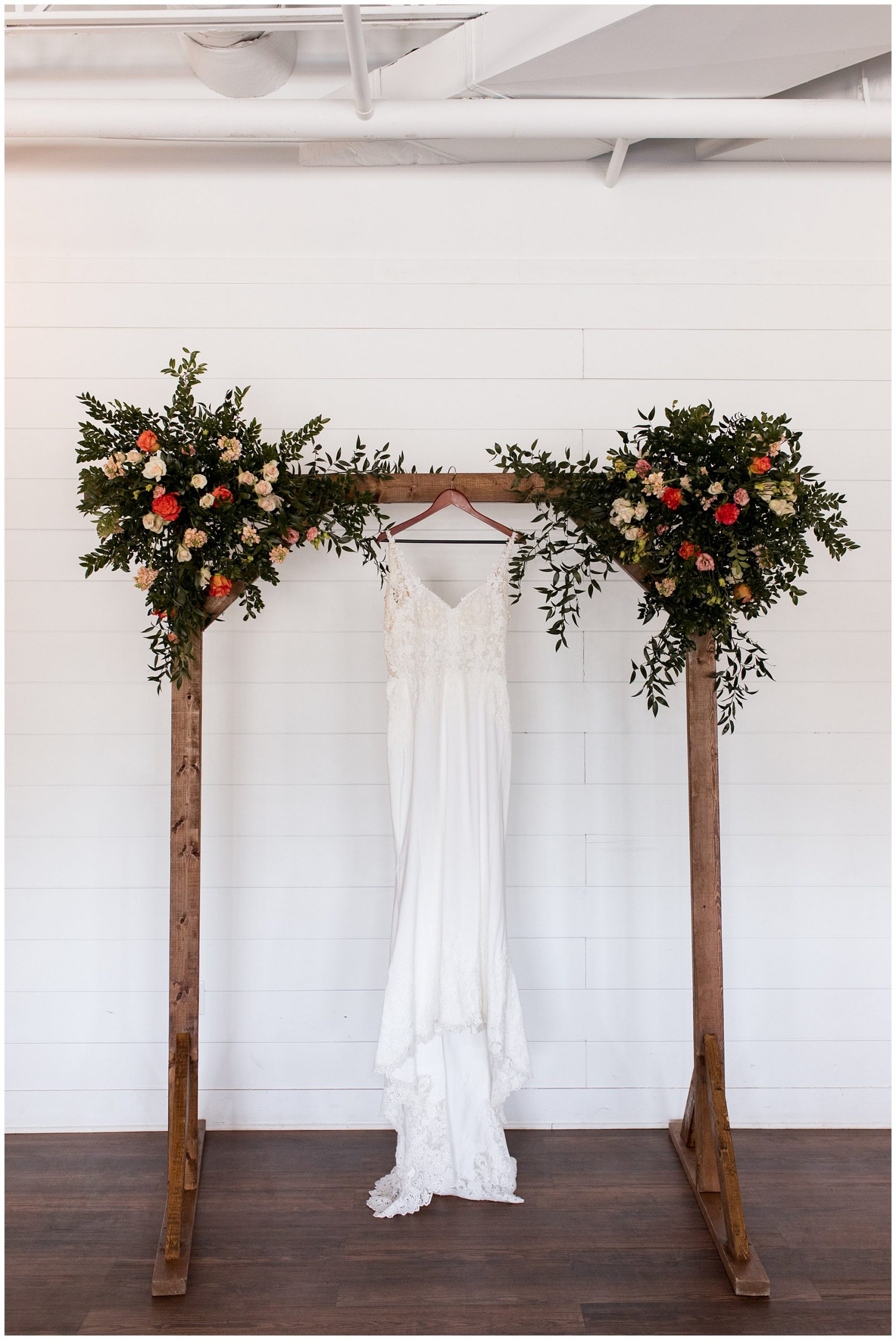 bride's dress hanging from archway at BASH venue in Carmel Indiana