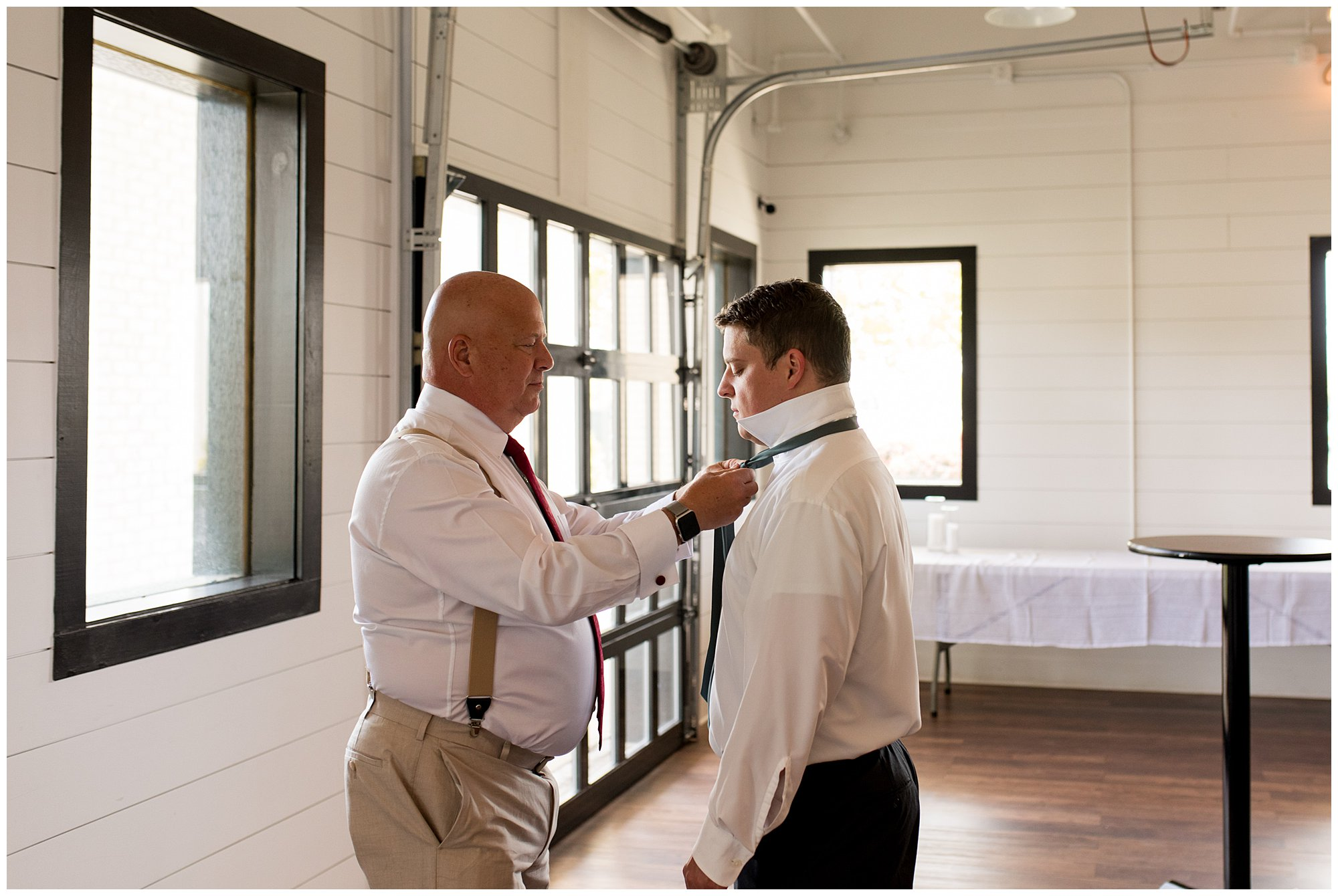 groom's father ties groom's tie before wedding ceremony at BASH in Carmel