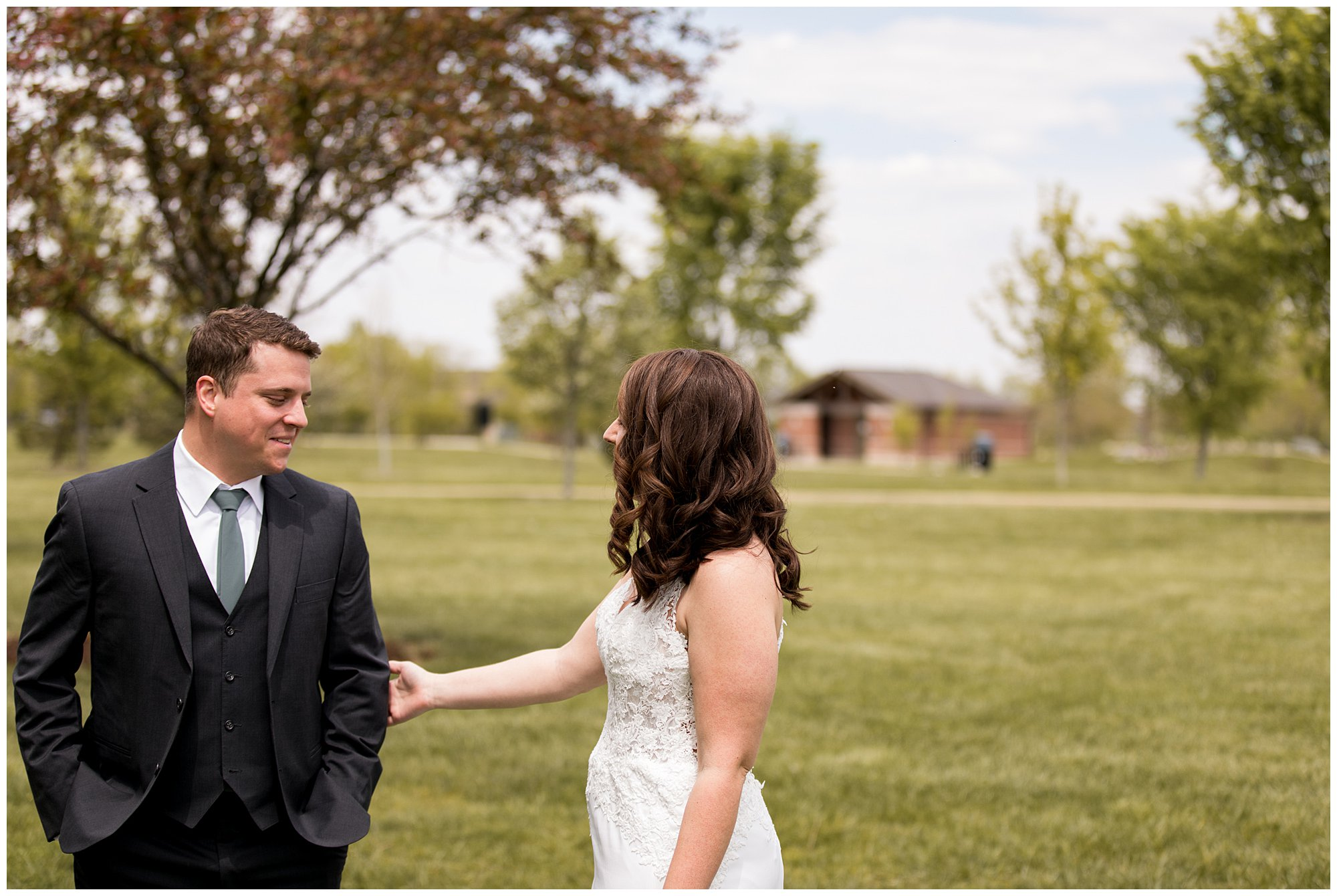 Bride and groom first look before wedding ceremony at Coxhall Gardens in Carmel Indiana