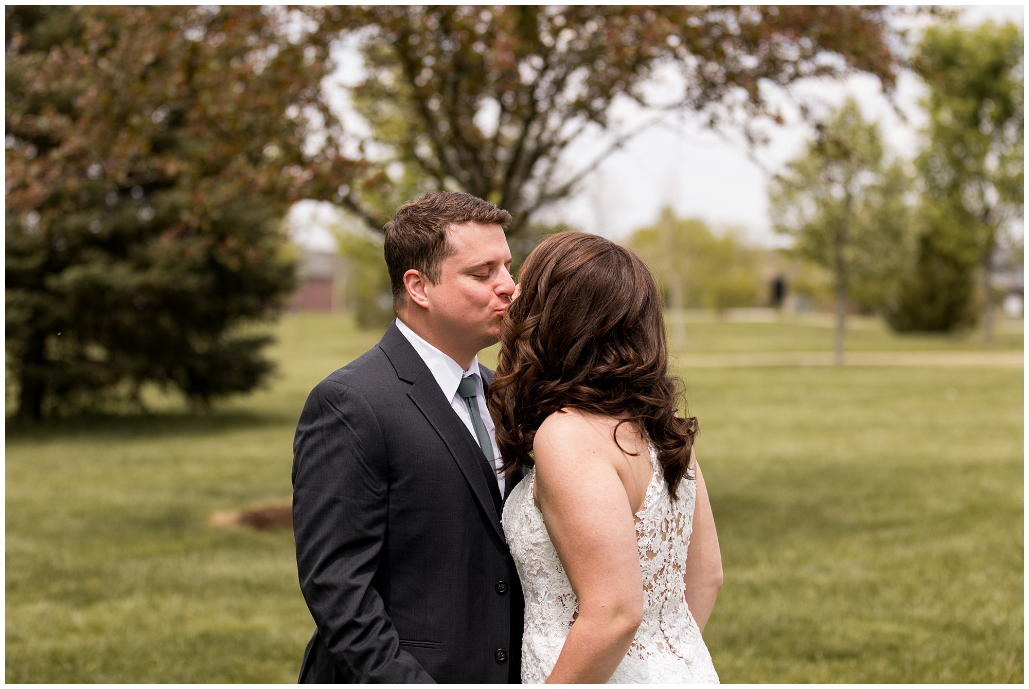 bride and groom kiss after first look at Coxhall Gardens in Carmel Indiana