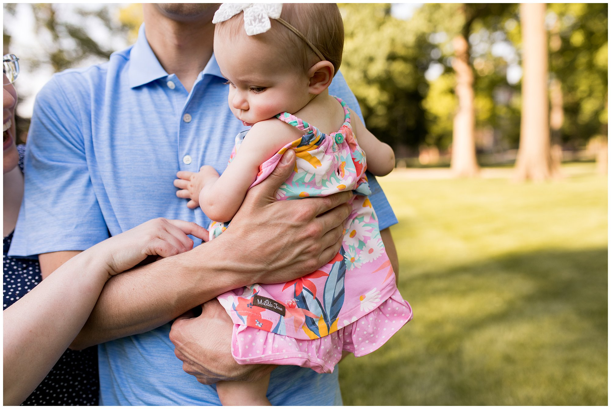 dad holds baby during Ball State University family session