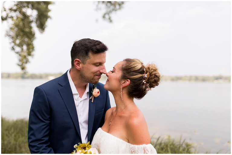 bride and groom touch noses after wedding ceremony at Lucerne Park