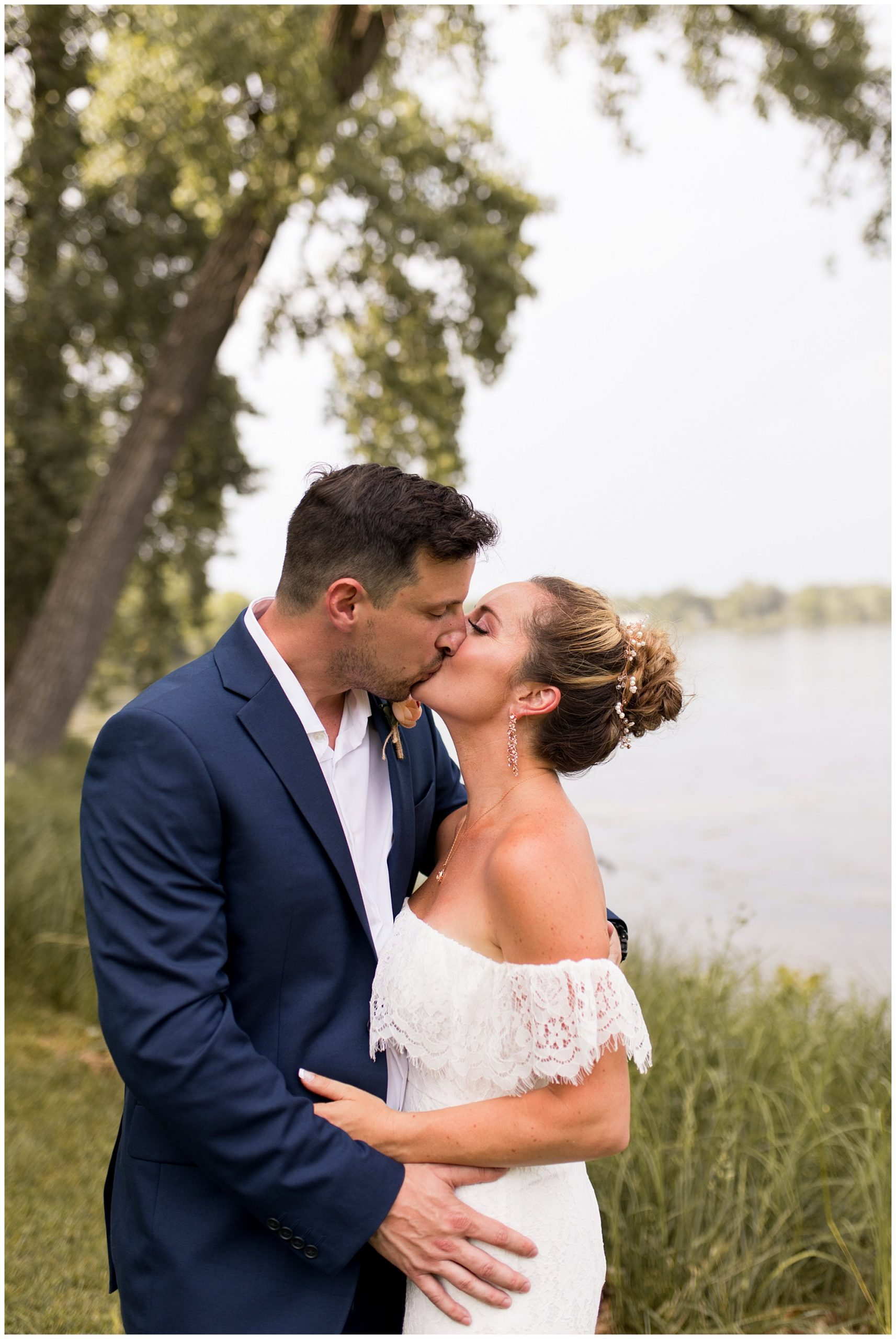 bride and groom kiss during wedding portraits at Lucerne Park