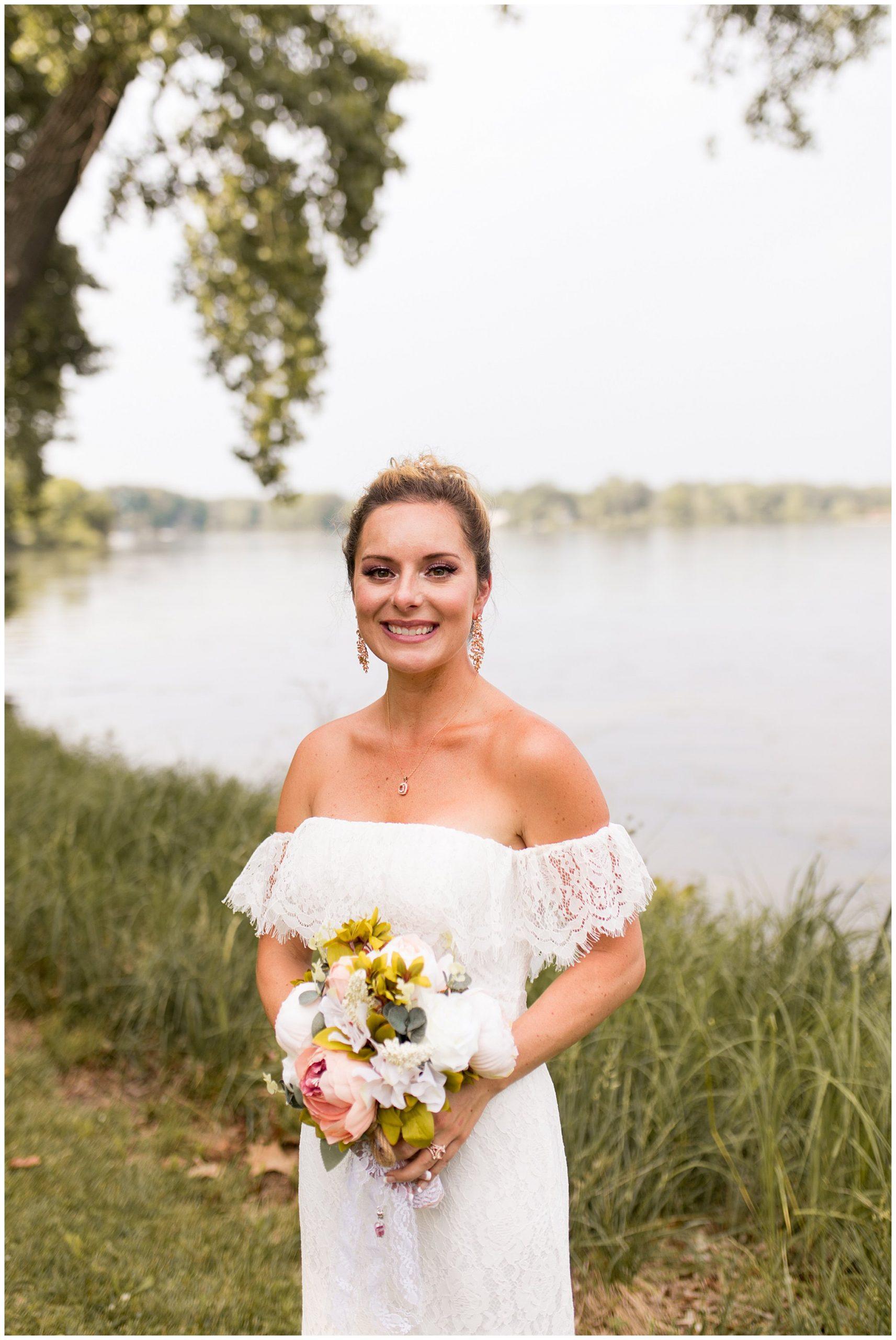bride holds bouquet after summer wedding at Lucerne Park