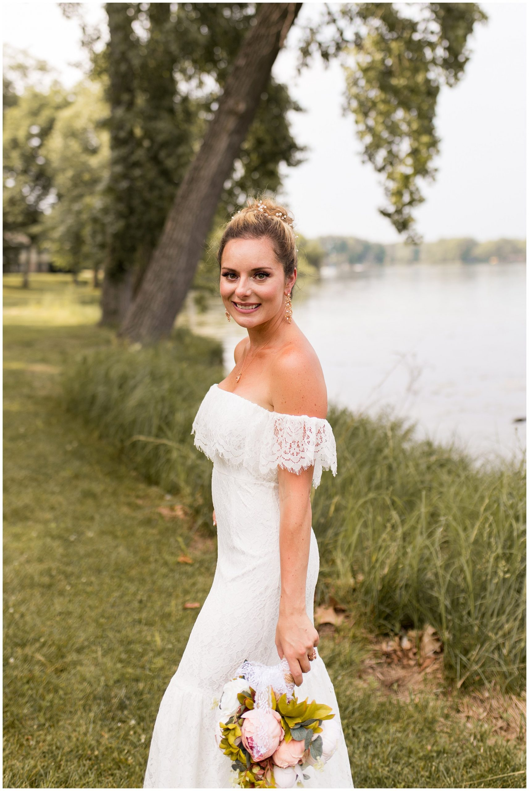 bride by water at Lucerne Park after wedding ceremony