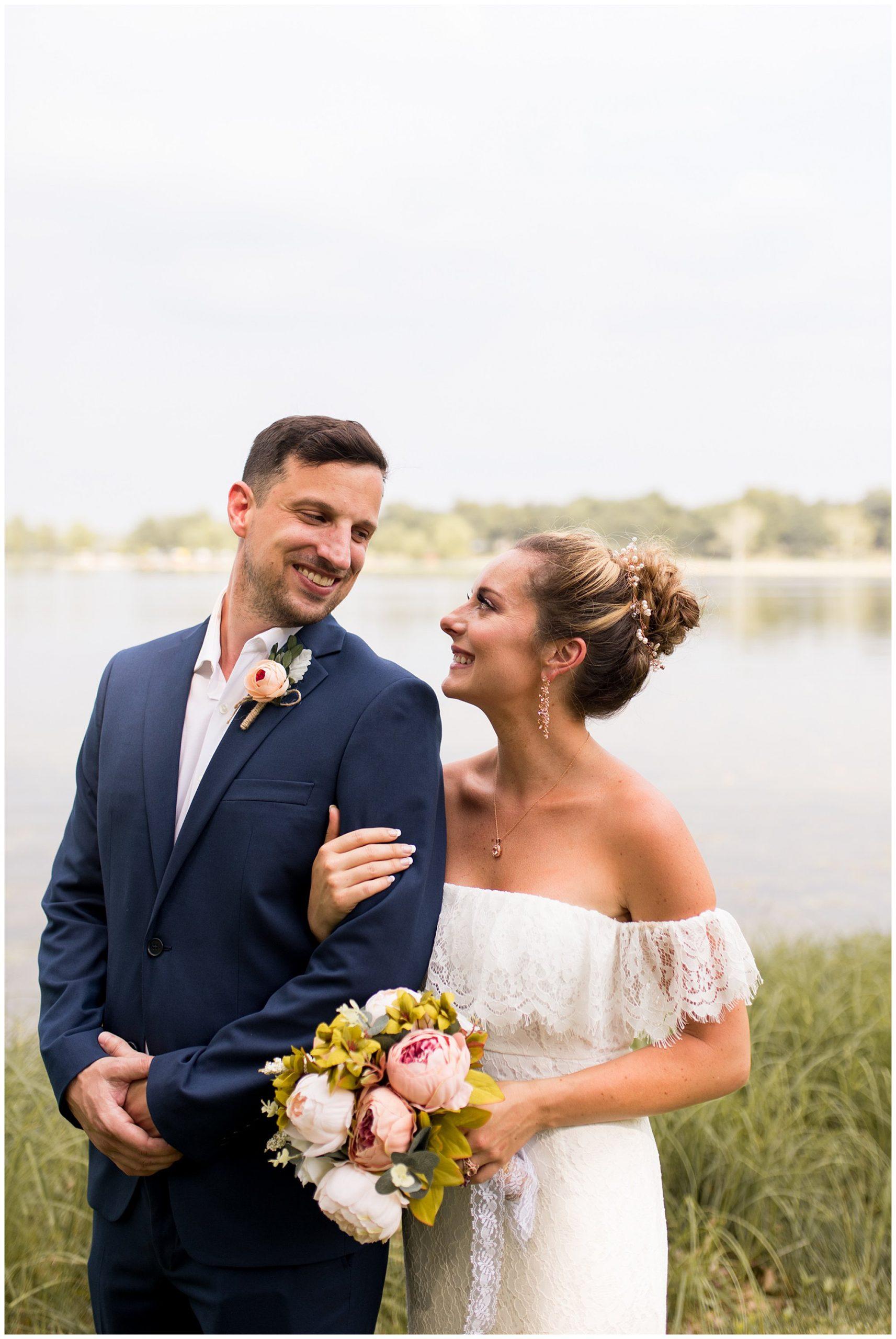 bride holds groom after wedding ceremony at Lucerne Park in Warsaw Indiana