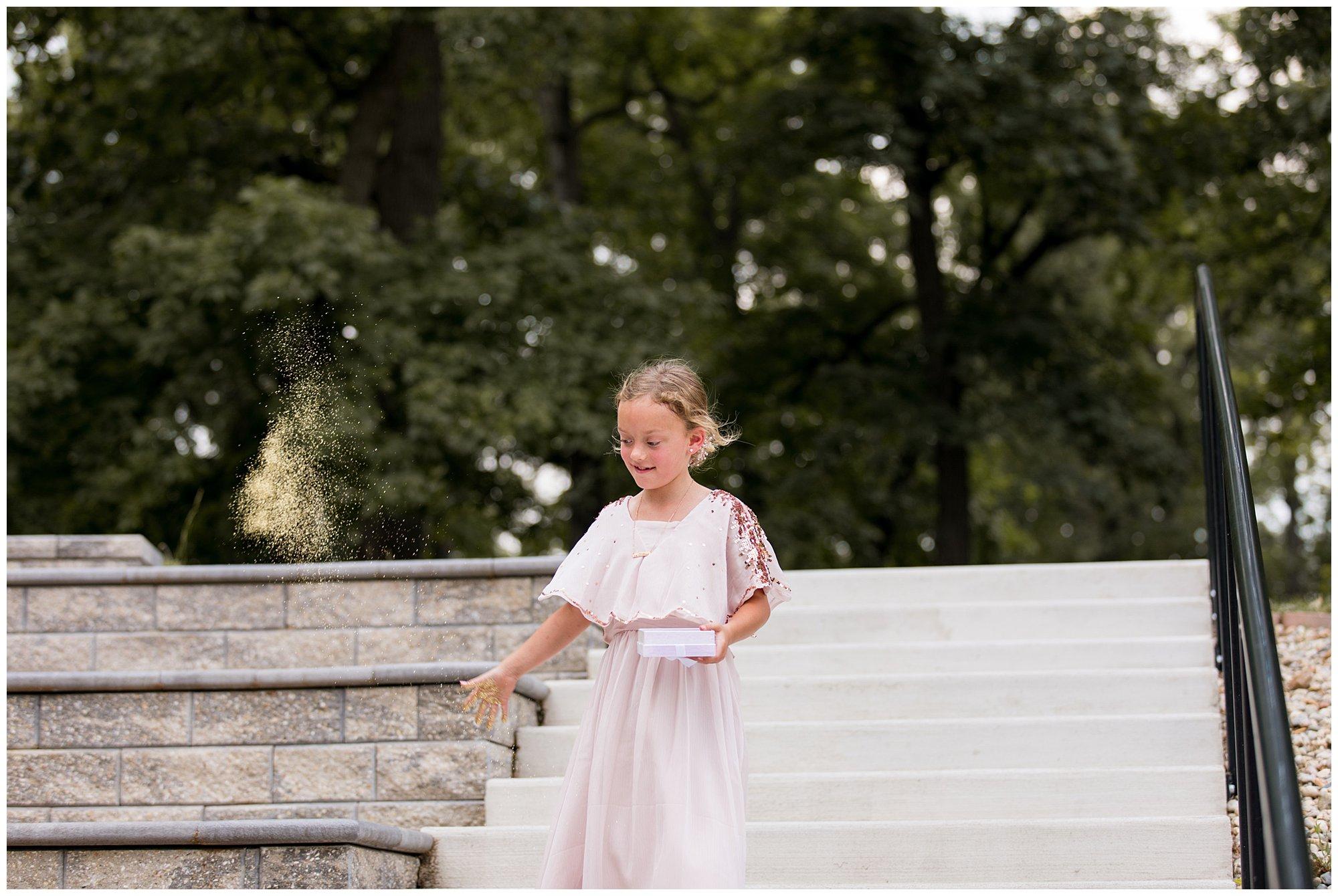 flower girl tosses glitter during wedding ceremony at Lucerne Park