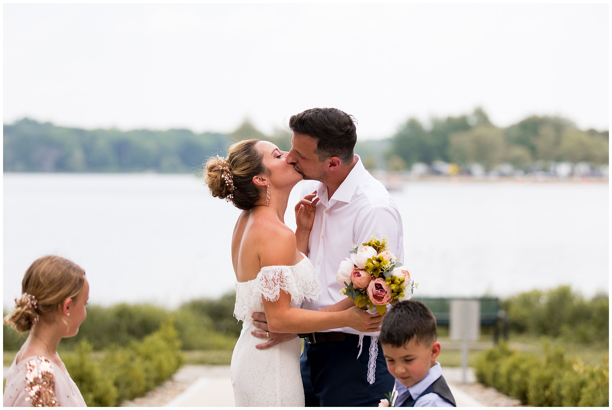 bride and groom kiss at the end of wedding ceremony at Lucerne Park in Warsaw Indiana