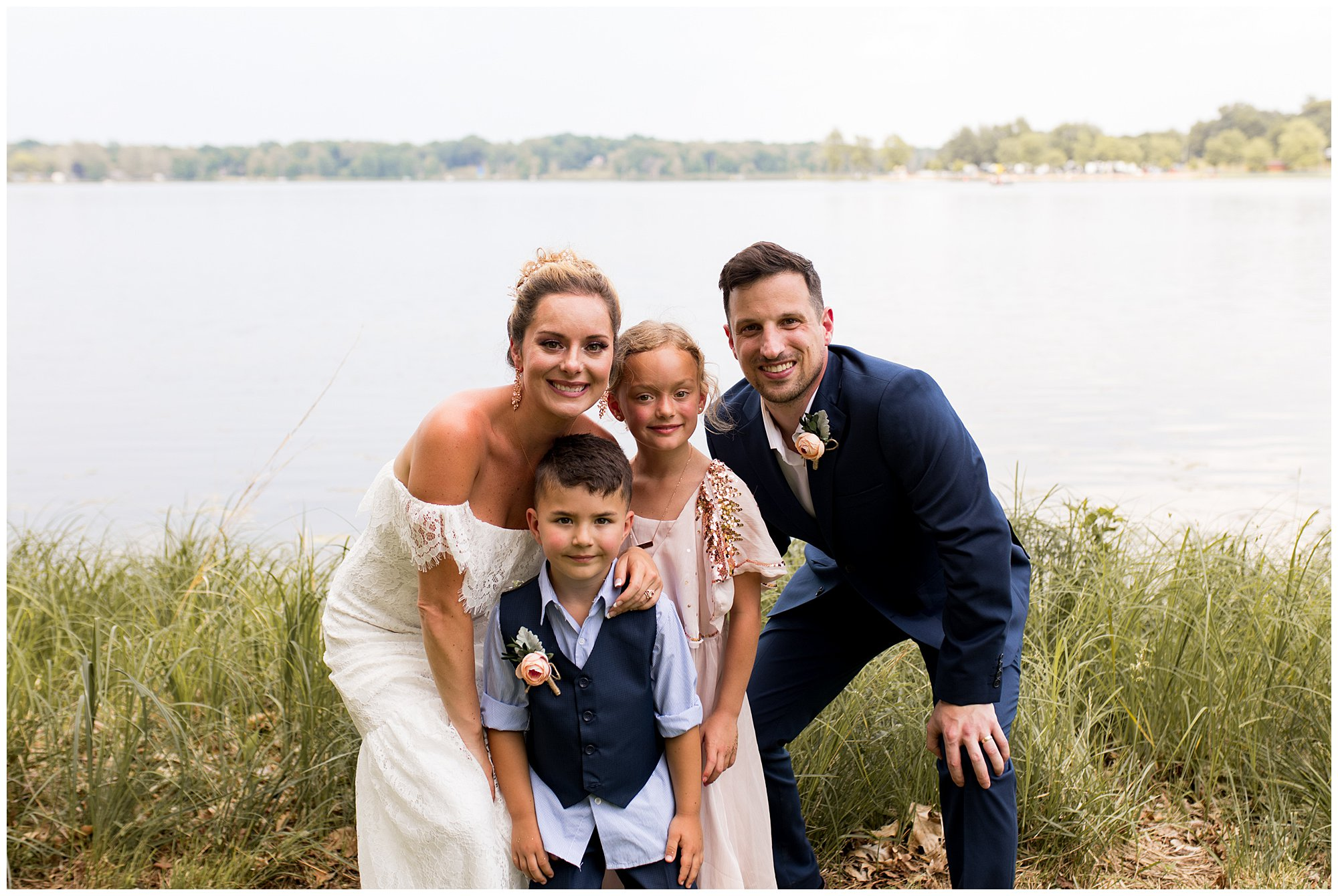 bride and groom with children after wedding ceremony in Warsaw Indiana