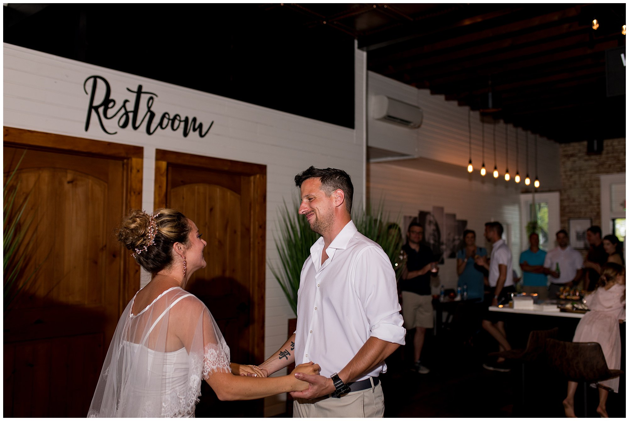 bride and groom dance during reception at Cafe Liefde in Syracuse, Indiana