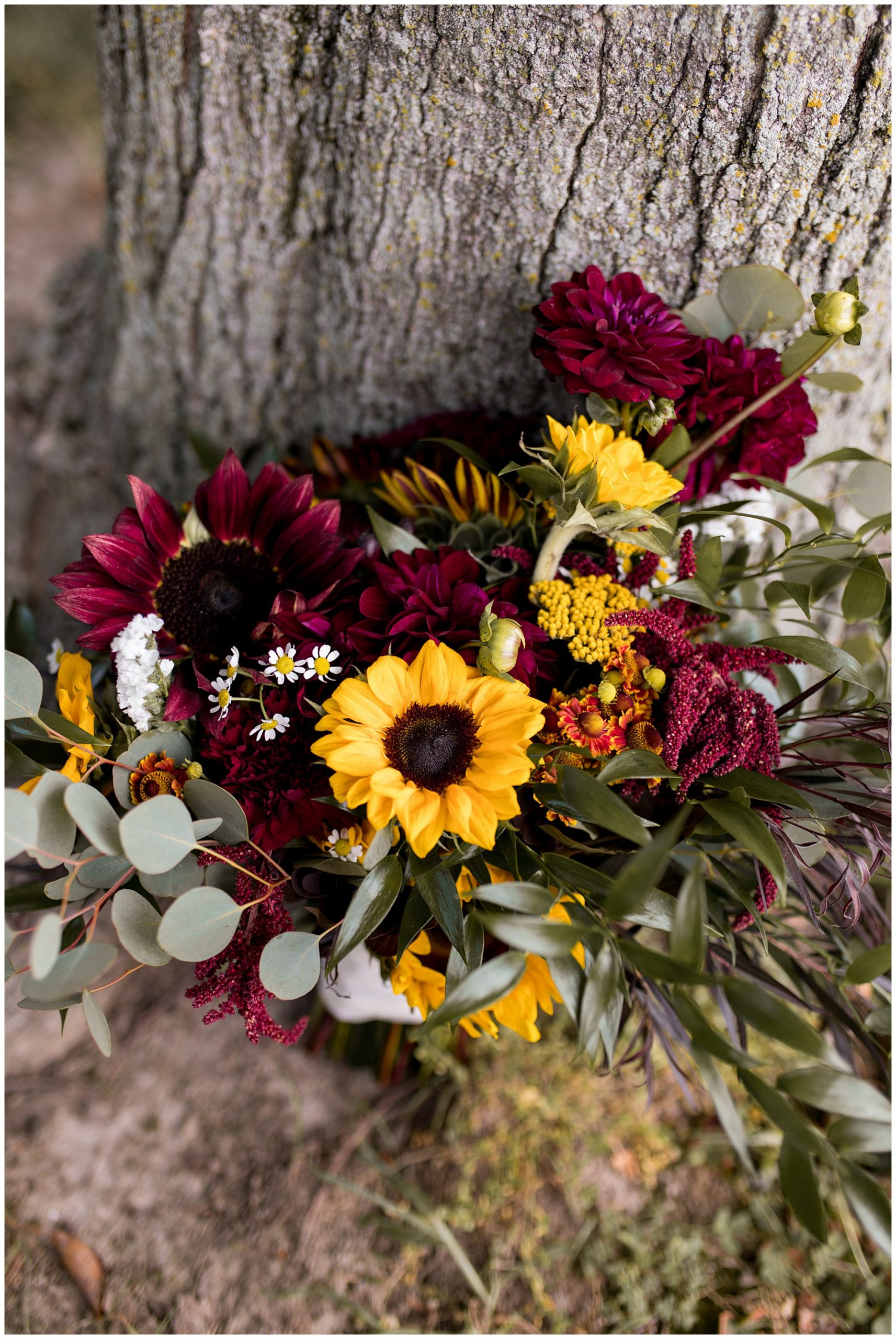 bride's bouquet with sunflowers and burgundy