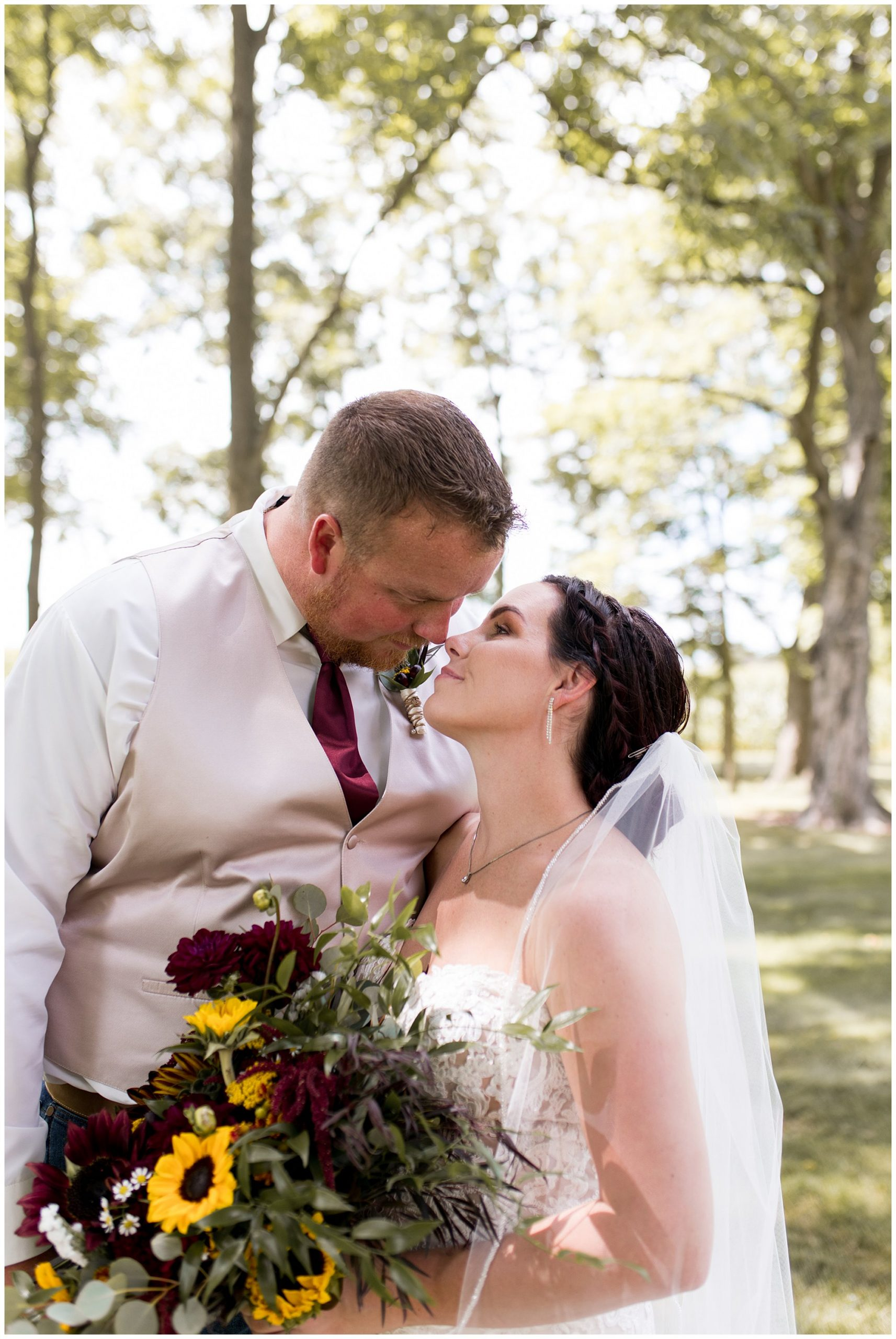 bride and groom lean in for kiss at Legacy Barn in Kokomo