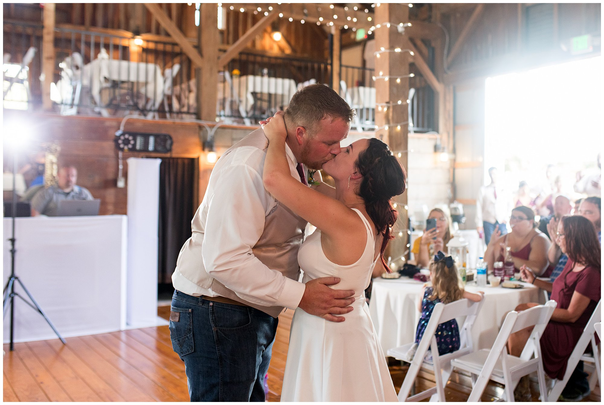 bride and groom kiss after first dance at Legacy Barn reception