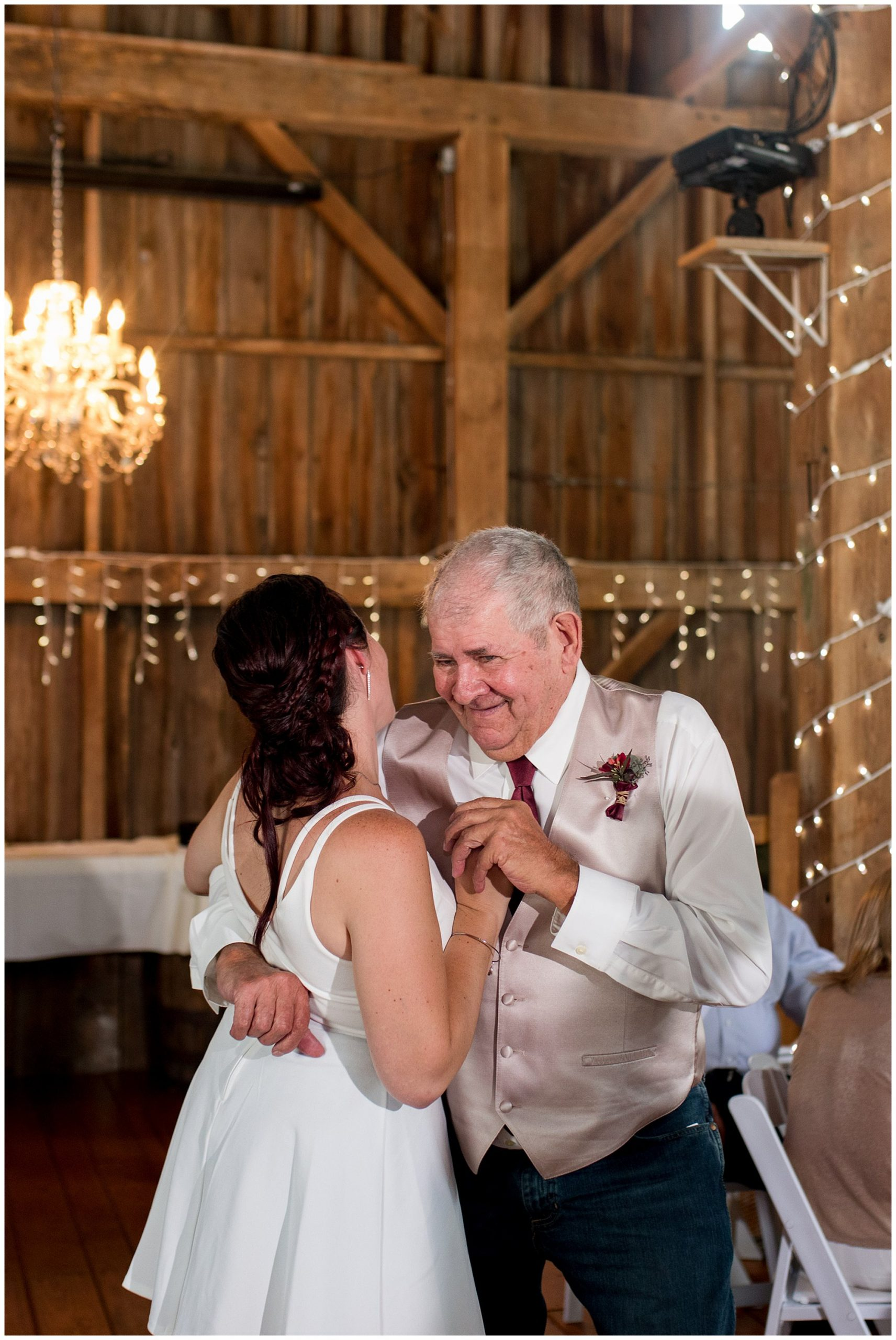 bride and grandpa share first dance at reception