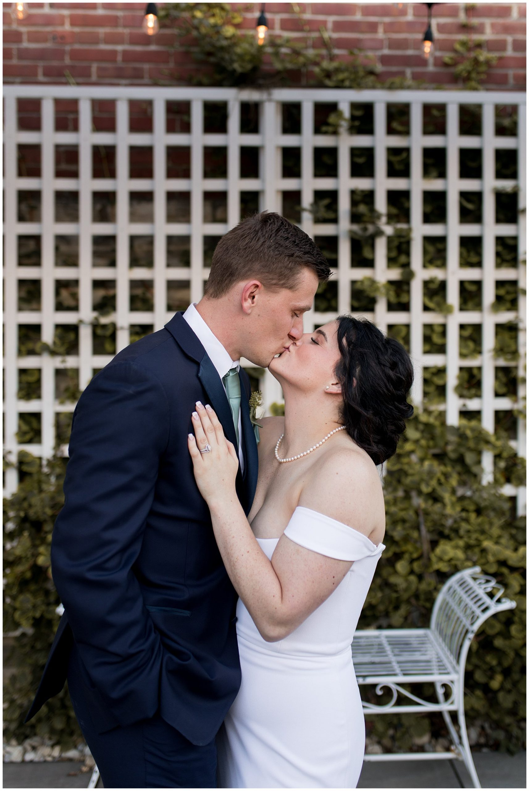bride and groom kiss outside The Hobson Kokomo wedding